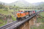 BNSF 4123 Passes over the bridge at Woodford